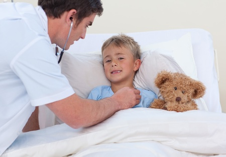 Doctor listening to a child breaht with stethoscope photo