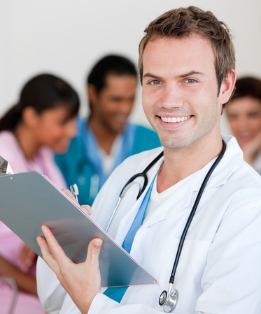 young male doctor: Young male Doctor Smiling at the camera Stock Photo