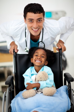 Young child being cared for by a doctor photo