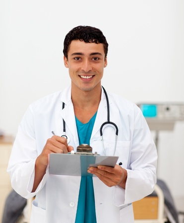 medic: Young male Doctor holding a clip board