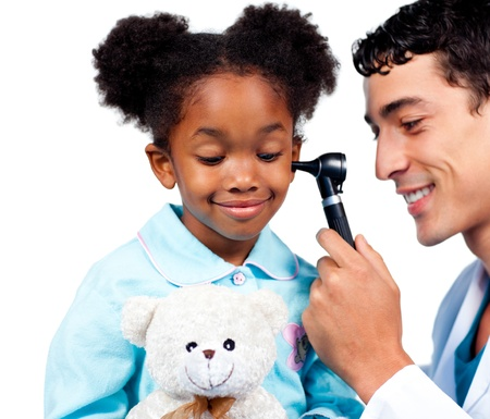 Male doctor examining his patients ears against a white background photo