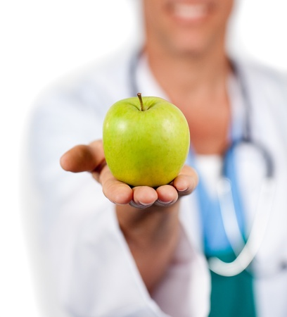 Close-up of a doctor presenting a green apple  photo