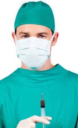 Young surgeon holding a syringe Stock Photo - 10245193