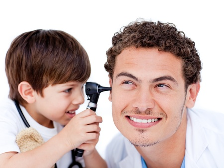 Adorable little boy playing with the doctor photo