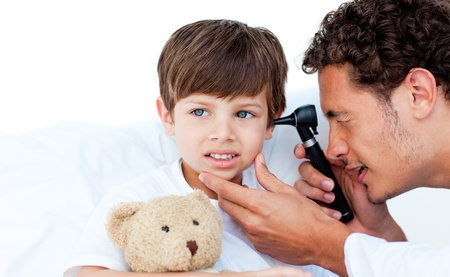Concentrated doctor examining patients ears photo