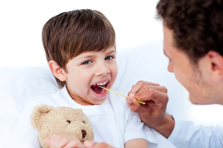 Young doctor taking little boy's temperature Stock Photo - 10259154