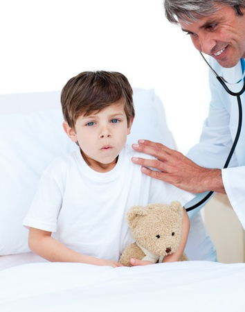 Cute little boy attending a medical check-up Stock Photo - 10232458