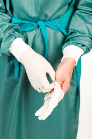 Surgeon before an operation with gloves Stock Photo - 10257226