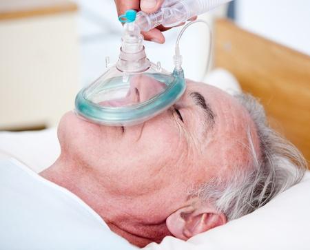 Senior patient receiving oxygen mask  photo