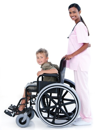 Wheel chair: Charming nurse with a young patient