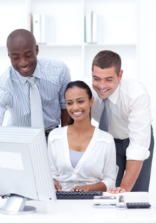 Two businessmen and businesswoman working together photo