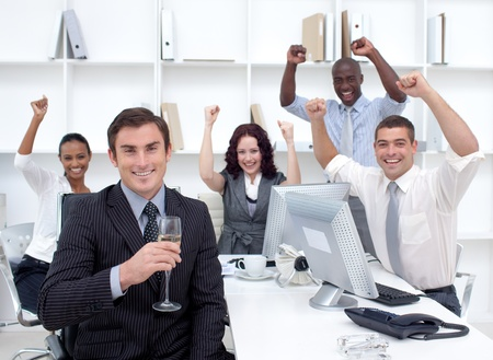 Happy businessteam celebrating a success in office photo