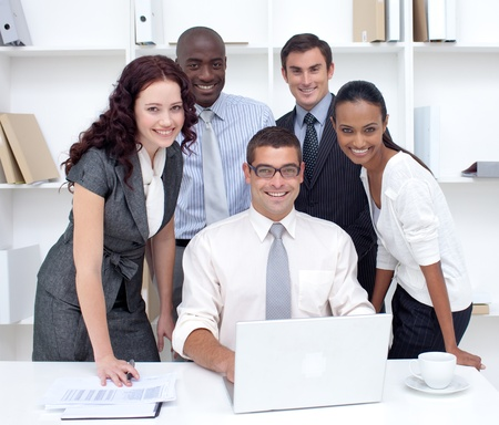 International business team using a laptop together Stock Photo - 10244029