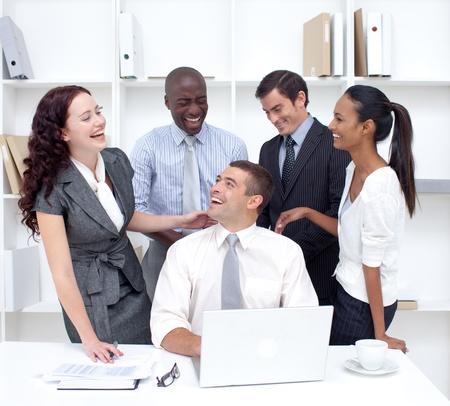 businessteam: International businessteam working and having fun