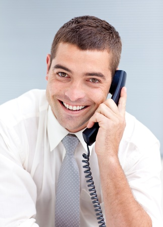 Charming businessman in office talking on phone photo
