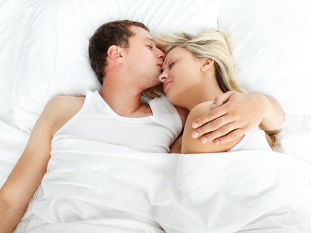 above head: Boyfriend kissing her girlfriend in bed