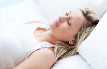 Beautiful young woman sleeping on a bed  photo