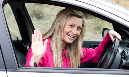 l plate: Joyful young female driver at the wheel Stock Photo