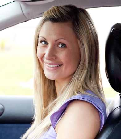 Portrait of a smiling young female driver  photo