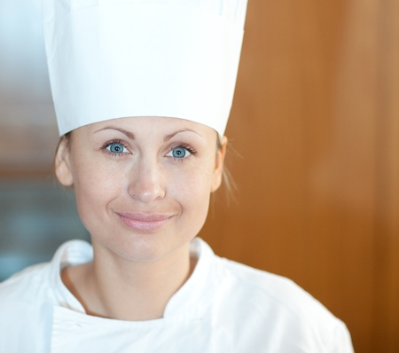 Portrait of a beautiful female chef. Stock Photo