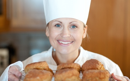 Close-up of a female chef baking scones photo