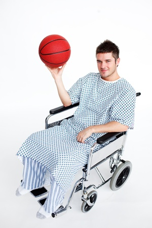 Patient in wheelchair holding a basket ball photo