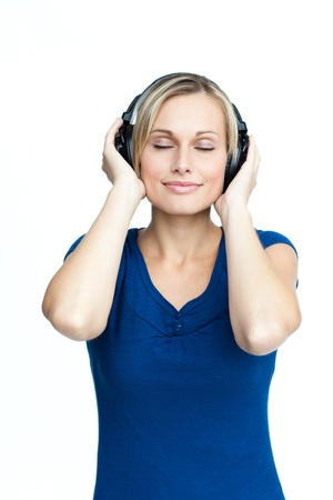 Happy woman listening to music with closed eyes photo