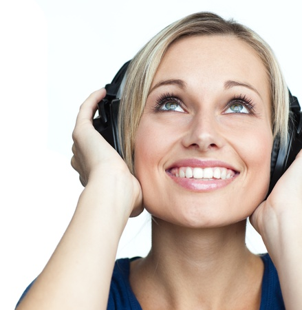 good looking woman: Happy woman listening to music with headphones on