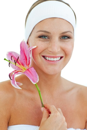 Delighted woman smelling a flower Stock Photo - 10258374