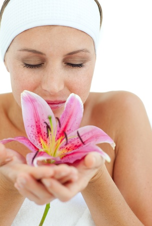 Beautiful woman smelling a flower  Stock Photo - 10257955