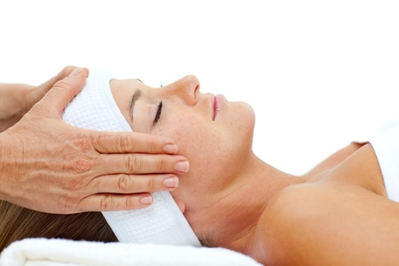 Attractive woman relaxing with head massage photo