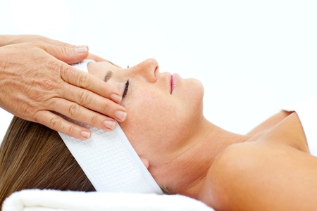 Asleep woman relaxing with head massage photo