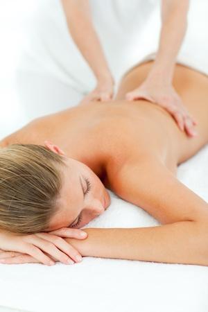 Jolly woman enjoying a massage Stock Photo - 10259497