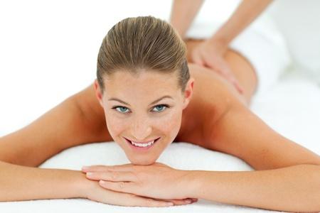 relaxation massage: Peaceful woman enjoying a massage Stock Photo