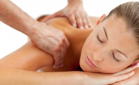 woman massage: Beautiful woman enjoying a massage Stock Photo