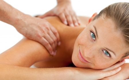 Smiling woman enjoying a massage Stock Photo - 10258726