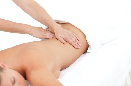 body massage: Young woman receiving a back massage