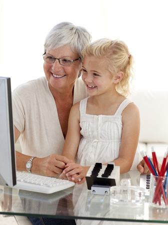 Granddaughter and grandmother using a computer photo