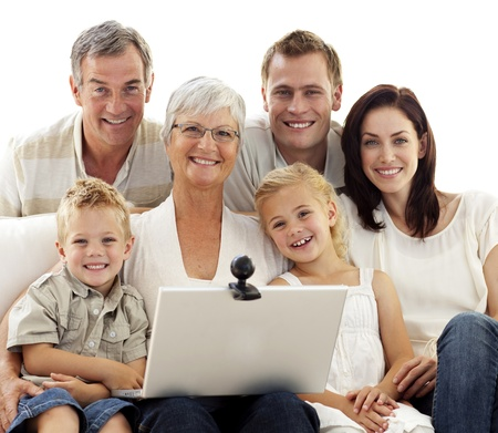 Happy family using a laptop at home photo