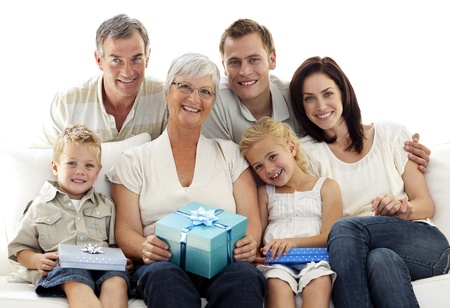 grandparents family: Family giving a present to grandmother