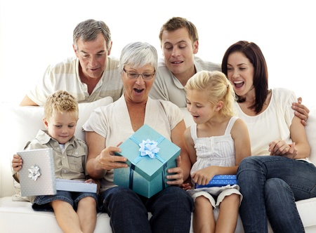 birthday adult: Family opening presents in grandmothers birthday Stock Photo