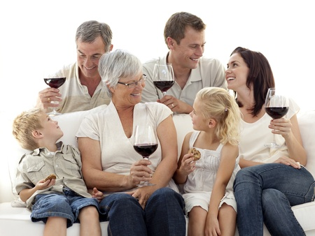 Family having a celebration with wine and eating biscuits photo