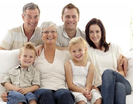 Portrait of family on sofa photo