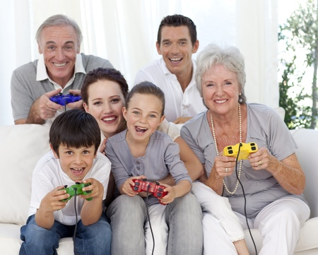 Family having fun playing video games Stock Photo - 10243908