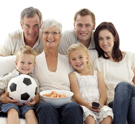 Family watching a football match at home photo