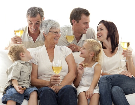 Family drinking wine and children eating biscuits photo
