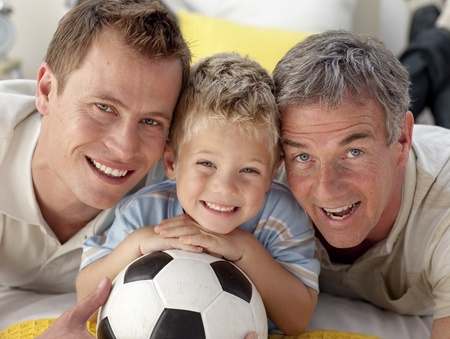 Portrait of smiling son, father and grandfather on floor photo