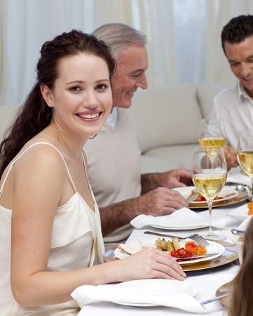 Woman in Christmas dinner with her family Stock Photo - 10258584