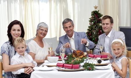 Family eating turkey in Christmas Eve Dinner Stock Photo - 10259550