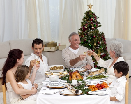 Grandparents and parents tusting in a Christmas dinner photo